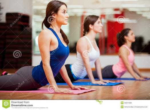 working-cobra-yoga-pose-cute-hispanic-women-practicing-their-class-gym-35911698